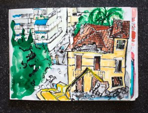 Doodlewash and watercolor sketch by Magny Tjelta of city street urban sketching sketcher